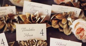 Sprayed pine cone wedding place name holders